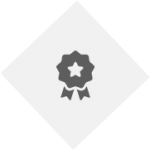 PNG image of award graphic. light grey diamond with dark grey badge with ribbons.